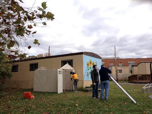 In November, a team of Young AFCEANs from the chapter build an outdoor supply shed to house materials for experiments and exercises at a local elementary school.